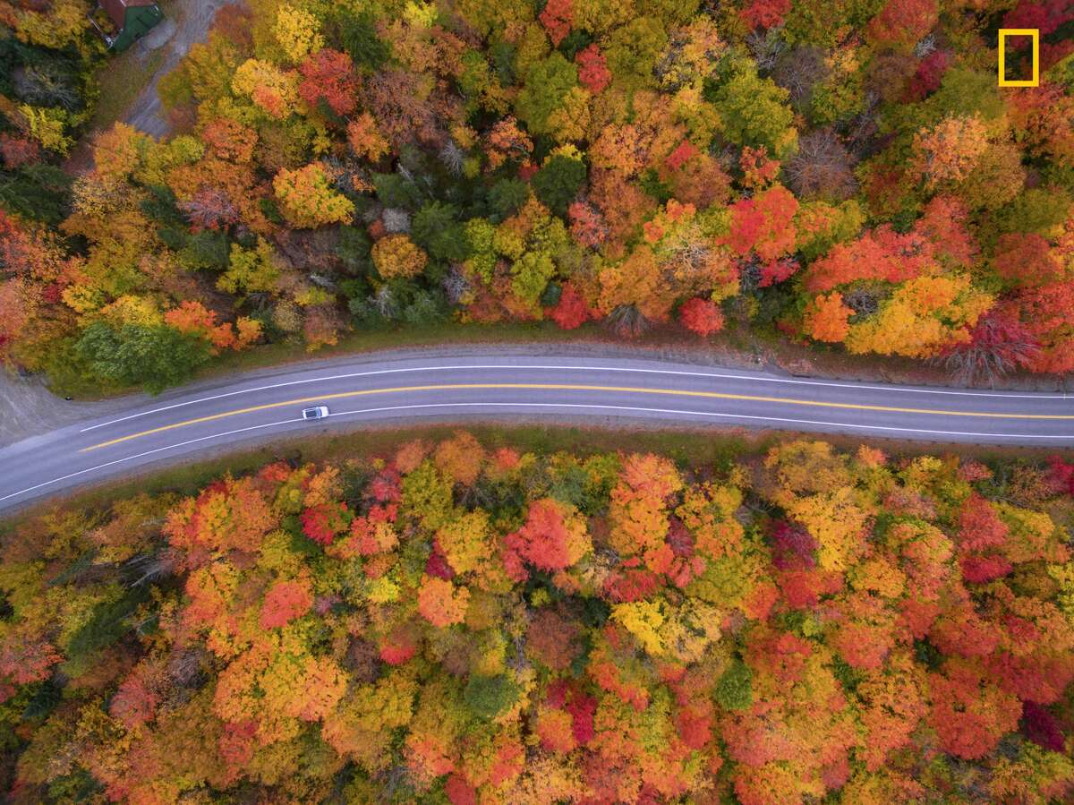 Aerial view of the Scenic drive and the beautiful Fall colors of New Hampshire. I used a drone to capture the fall colors that cannot be seen from the road.