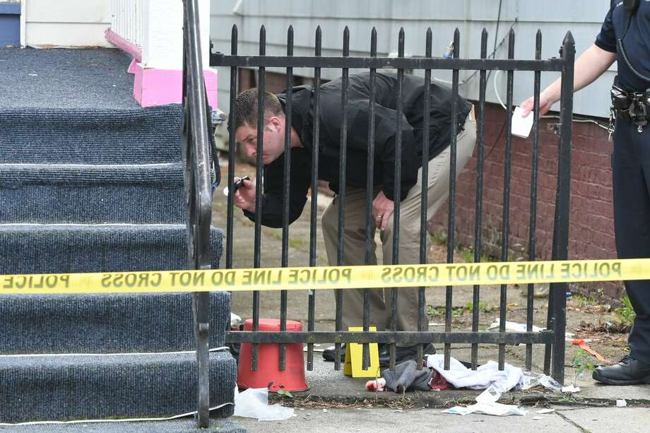 Police investigate a shooting on First Street in Albany on Tuesday. One person was shot in the leg and taken to the hospital. Photo: Will Waldron / Times Union