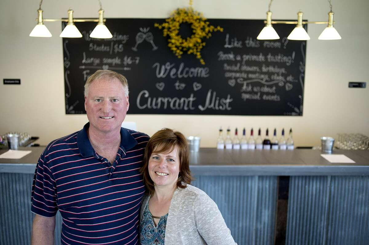 """Currant Mist Winery and Tasting Room owners Jerry and Julia Coon pose for a portrait in the newly opened tasting room in Coleman Thursday afternoon. The Coons opened the winery and tasting room April 13 and use gooseberries, red currants and black currants grown on their farm, Coon's Berry Farm, to make wines, syrups, vinegars and teas. The winery and tasting room is open Tuesday to Thursday 11a.m.- 7 p.m., Friday to Saturday 11a.m. - 8 p.m. and Sunday 12 p.m. - 5 p.m. """"We're breaking ground, no one knows what black currant tastes like,"""" Jerry said."""