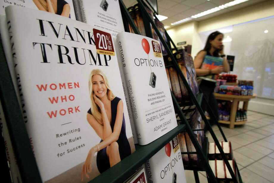 """A woman walks past a shelf displaying Ivanka Trump's book """"Women Who Work: Rewriting the Rules for Success"""" at a Barnes and Noble bookstore in New York. Trump is donating the proceeds to charity and has opted not to do any publicity to avoid any suggestion that she is improperly using her White House platform. Photo: Jewel Samad /AFP /Getty Images / AFP or licensors"""