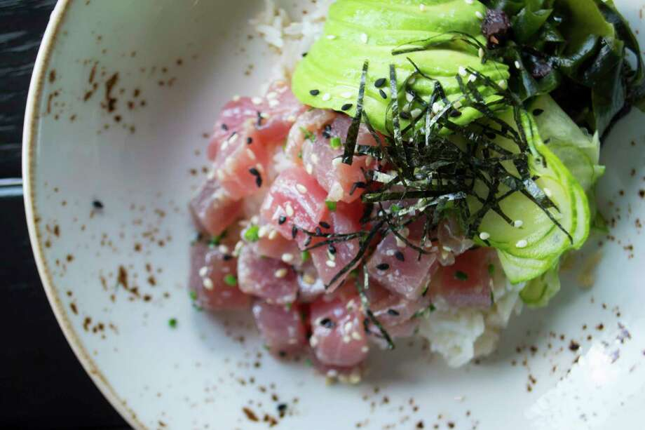 Tuna Poke Served With Sushi Rice Avocado Cuber Seaweed Salad And White