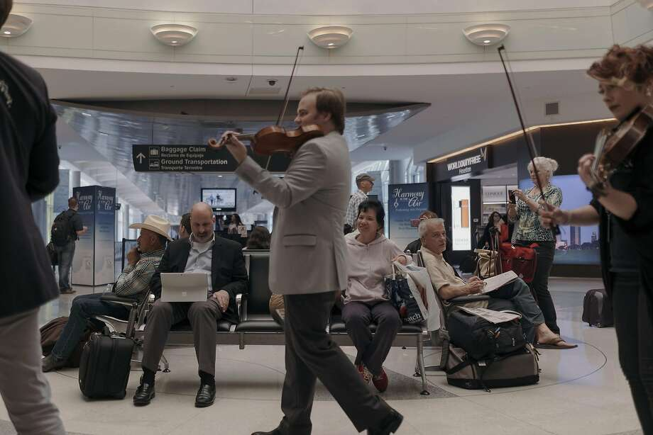 The Apollo Chamber Players perform classical music for travelers at William P. Hobby Airport in Houston. Photo: TODD SPOTH, NYT