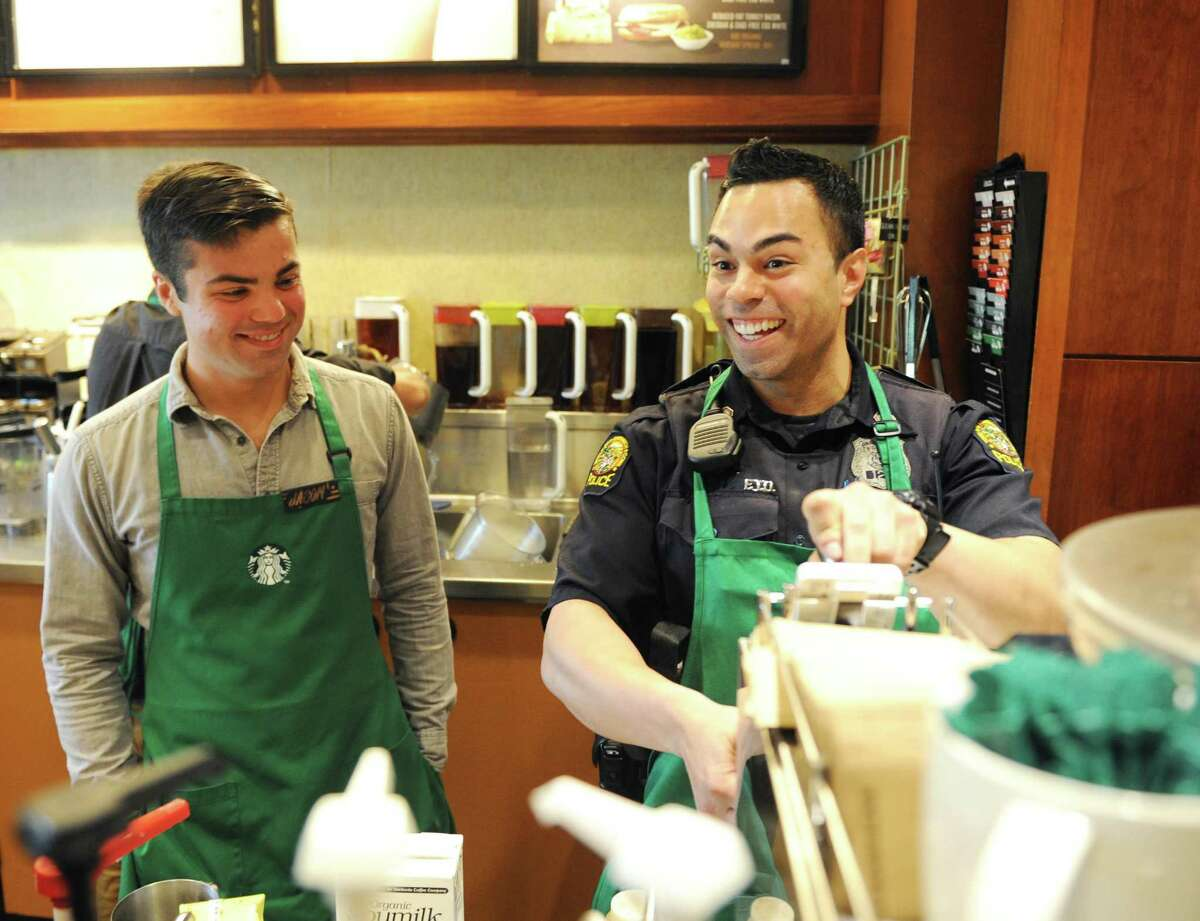Starbucks employee Jason LaGuardia and Officer Justin Rivera make drinks during the Coffee with a Cop event at the Starbucks in the Riverside section of Greenwich, Conn. Tuesday, May 2, 2017. The event allowed citizens to chat with Greenwich police officers in a casual setting to give them a feel for the men and women behind the uniforms.