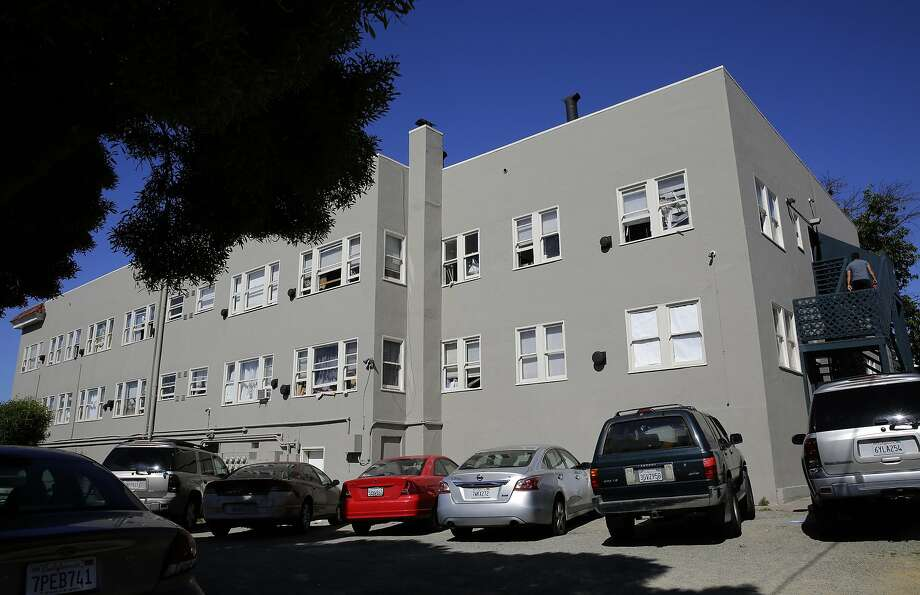A housing complex on the corner of 21 Street and International Boulevard is seen in the San Antonio neighborhood of Oakland on Tuesday. The city's pilot inspection program, which recently ended, examined apartments like this one. Photo: Michael Macor, The Chronicle
