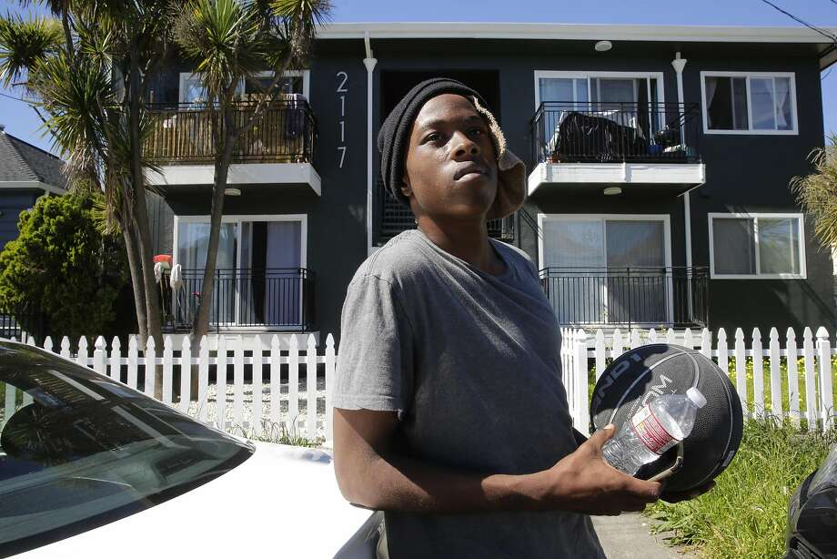 Hasinnie Bennett, 21, lives with his grandparents in a 10-unit housing complex on the 2100 block of East 15th Street in the San Antonio neighborhood of Oakland. Bennett said inspectors dropped by several months ago and found one of their smoke detectors needed to be replaced. Photo: Michael Macor, The Chronicle