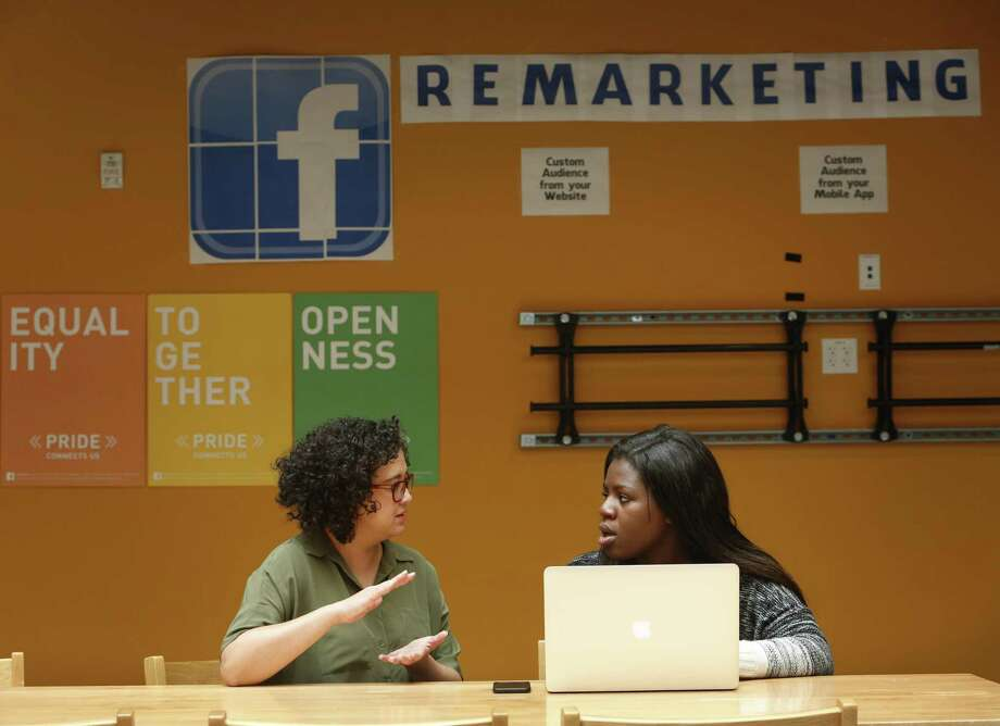 Holly Hagen (left), product designer with the Ads Growth team talks with Facebook product design intern Zainab Aliyu last summer on the Facebook campus in Menlo Park, California. According to a new report by the jobs site Glassdoor, the 25 best-paying companies for internships each pay their median summer worker more than $4,500 a month. Topping the list was Facebook, where the median pay for interns is $8,000 a month, according to the reports from the newest analysis. Photo: Lea Suzuki /San Francisco Chronicle / ONLINE_YES