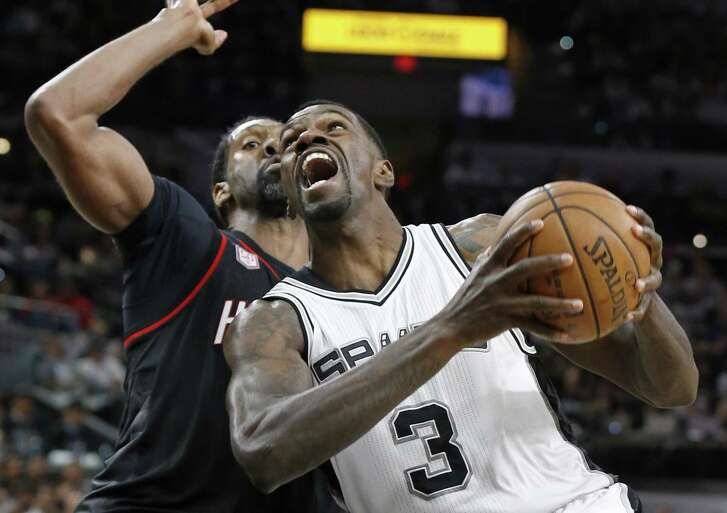 Spurs' Dewayne Dedmon looks for room around the Houston Rockets' Nene during second half action of Game 1 in the Western Conference semifinals on May 1, 2017 at the AT&T Center.