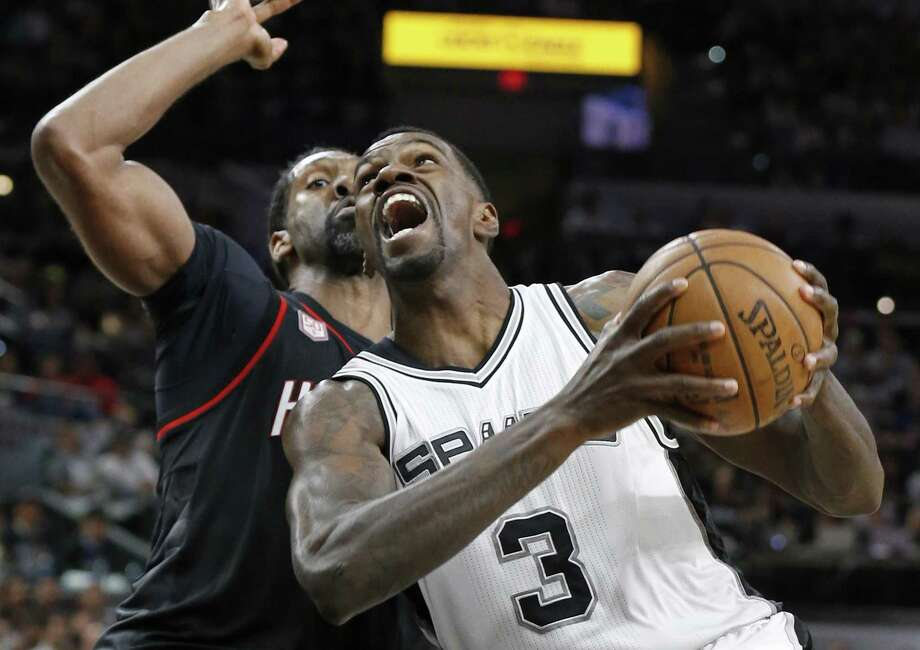 Spurs' Dewayne Dedmon looks for room around the Houston Rockets' Nene during second half action of Game 1 in the Western Conference semifinals on May 1, 2017 at the AT&T Center. Photo: Edward A. Ornelas /San Antonio Express-News / © 2017 San Antonio Express-News
