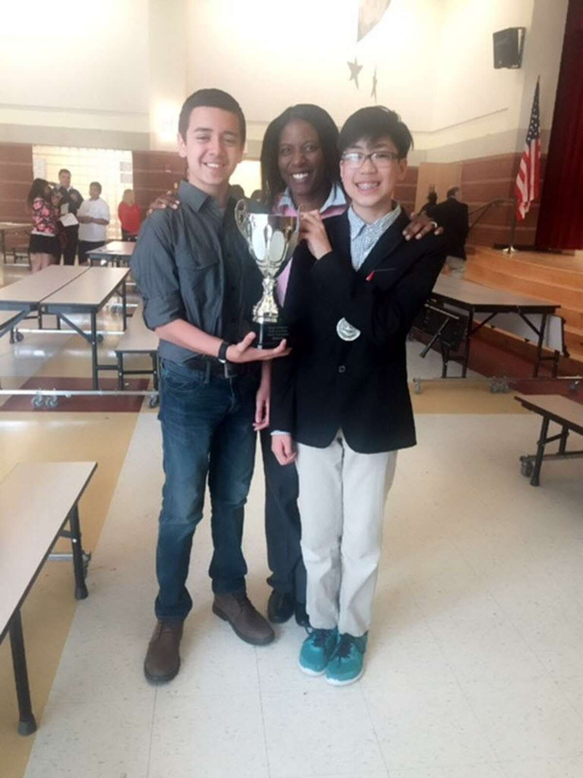 Winners of the 2016 Bridgeport Debate Competition, Discovery Magnet Schoolwith their coach Careen Derise.