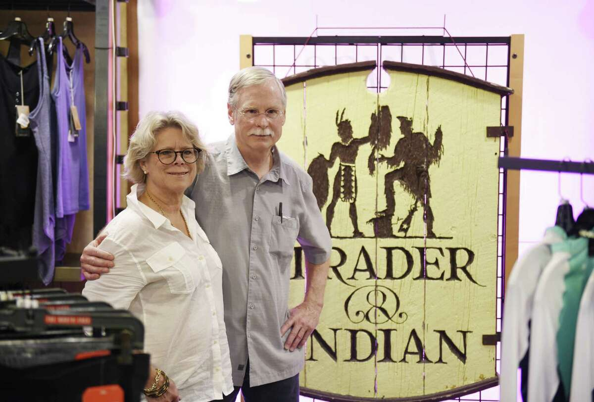 Store owners Jean and Dick Hoyt pose in front of the original sign at Outdoor Traders during the store's liquidation sale in Greenwich, Conn. Tuesday, May 2, 2017. The Hoyts are retiring are 27 years of business and the store is liqiudating all items, from clothing and skis to store fixtures and furniture.
