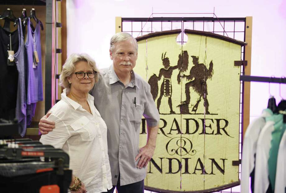 Store owners Jean and Dick Hoyt pose in front of the original sign at Outdoor Traders during the store's liquidation sale in Greenwich, Conn. Tuesday, May 2, 2017. The Hoyts are retiring are 27 years of business and the store is liqiudating all items, from clothing and skis to store fixtures and furniture. Photo: Tyler Sizemore / Hearst Connecticut Media / Greenwich Time