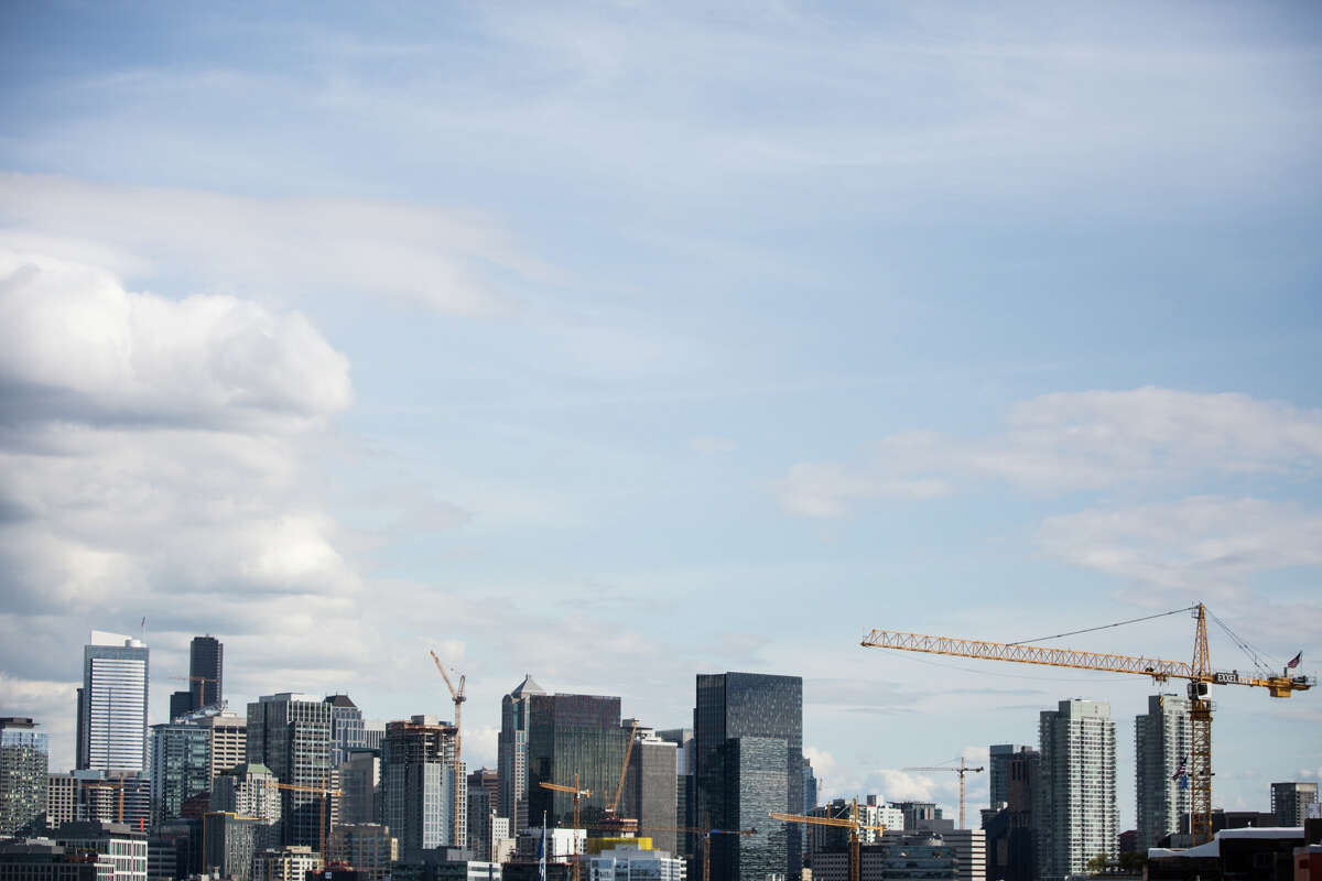 10 construction cranes dot the Seattle skyline, seen from a roof of a Dexter Ave N apartment building on Friday, April 28, 2017.