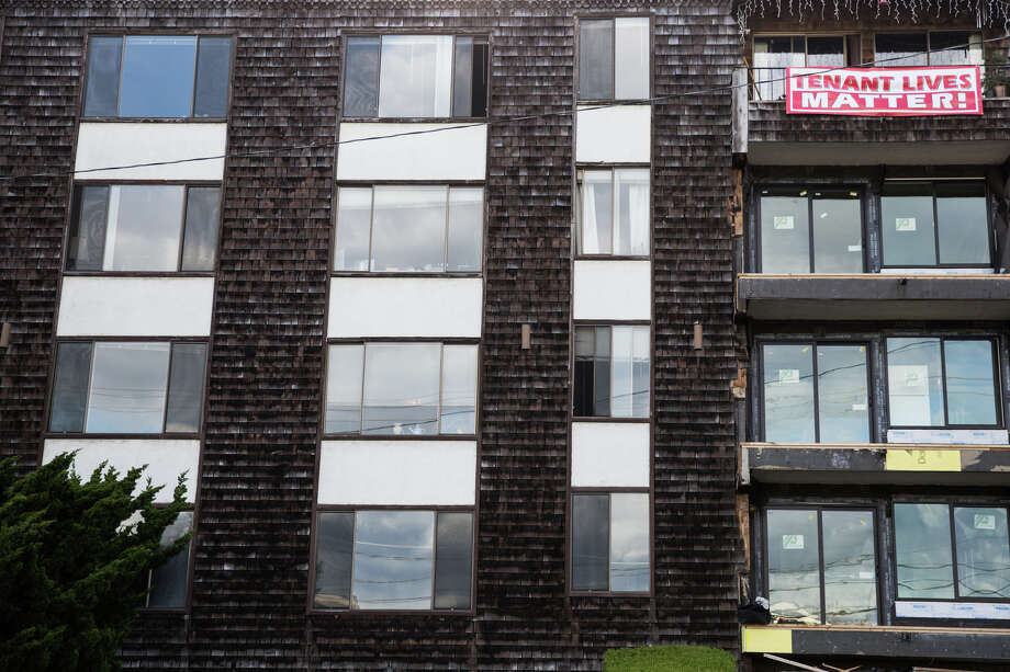 "Residents display a ""Tenant Lives Matter!"" sign showing their frustration with their building's new owners, on Friday, April 28, 2017. Residents saw rent increases as much as 121 percent over previous rents ahead of construction work earlier this year in the Lake Union building. The new owners say the increase brings the rent to average for the area. Photo: GRANT HINDSLEY, SEATTLEPI.COM / SEATTLEPI.COM"