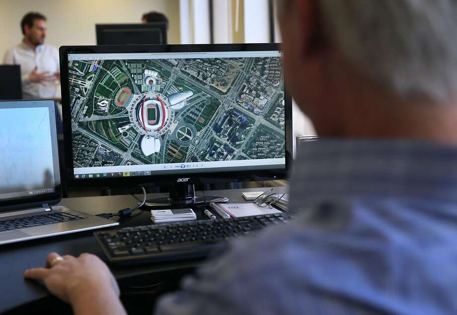 James Crawford, founder of Orbital Insight in Mountain View, analyzes a satellite image of the Olympic Stadium in Nanjing, China, in 2015. Photo: Paul Chinn, The Chronicle