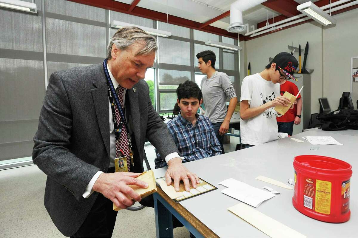 AITE math teacher Vin Urbanowski, the Stamford Teacher of the Year, helps senior Austin Cappetta, 18, build a wooden model airplane during an Intro to Aerospace Engineering class at AITE in Stamford, Conn. on Tuesday, May 2, 2017.