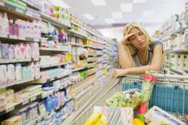 This Getty stock images shows an unhappy woman shopping in a store. (Dan Dalton)