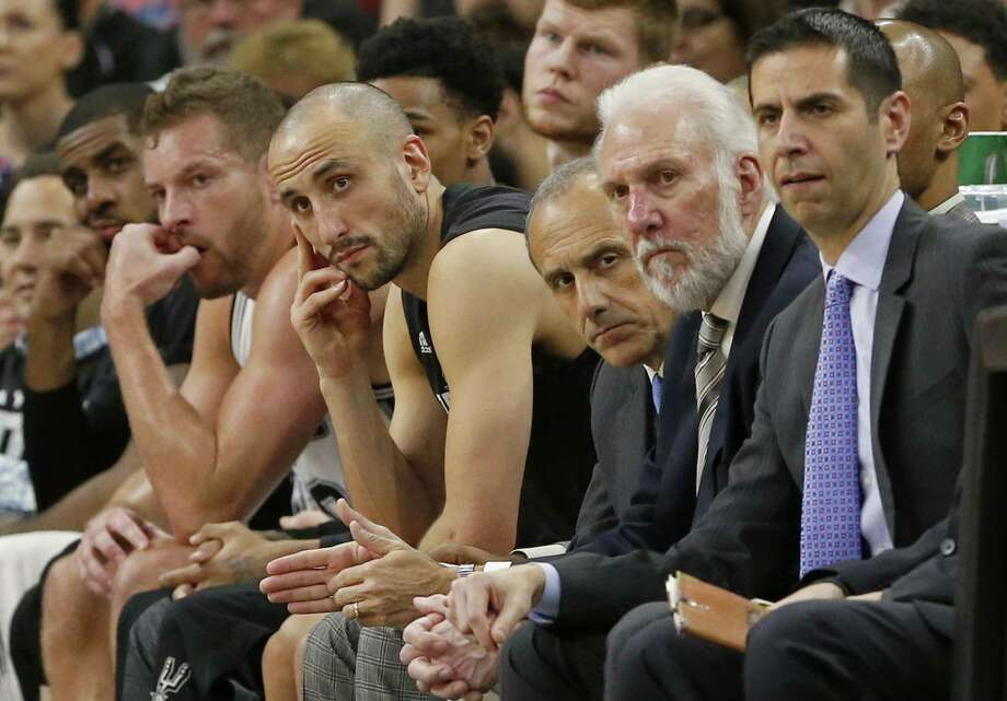 Spurs' LaMarcus Aldridge (from left), David Lee, Manu Ginobili, assistant coach Ettore Messina, head coach Gregg Popovich and assistant coach James Borrego watch second half action of Game 1 against the Houston Rockets from the bench on May 1, 2017 at the AT&T Center. Photo: Edward A. Ornelas /San Antonio Express-News / © 2017 San Antonio Express-News