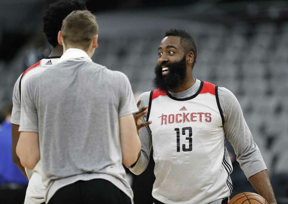 Houston Rockets guard James Harden laughs with center Clint Capela during practice at the AT&T Center as they prepare for Game 2 on May 2, 2017, in San Antonio. Photo: Karen Warren /Houston Chronicle / 2017 Houston Chronicle