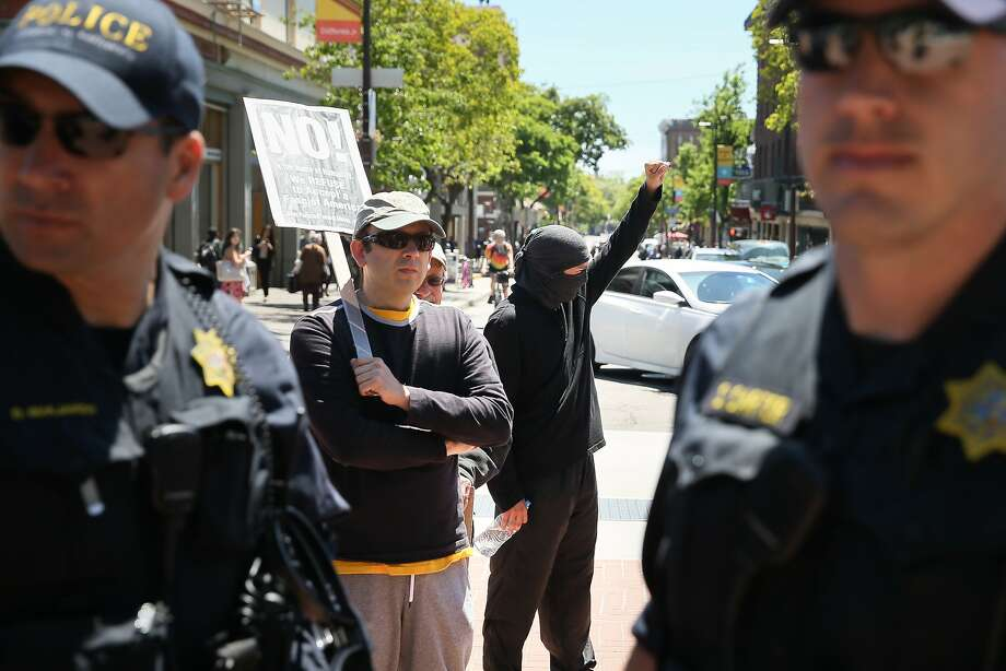 BERKELEY, CA - APRIL 27: A protester raises his fist after speaking with police officers at UC Berkeley on April 27, 2017 in Berkeley, California. Protestors gathered in Berkeley to protest the cancellation of a speech by American conservative political commentator Ann Coulter at UC Berkeley. (Photo by Elijah Nouvelage/Getty Images) Photo: Elijah Nouvelage, Getty Images