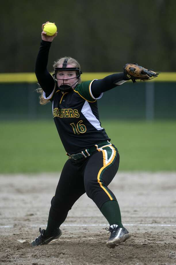Dow High's Grace Pnacek pitches in the first inning of Dow's home game against Lapeer High School Tuesday afternoon. Photo: Brittney Lohmiller/Midland Daily News/Brittney Lohmiller