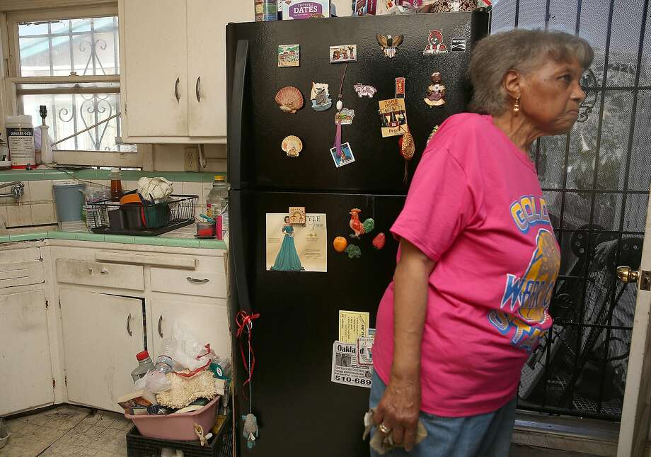 Dorothy DeBose, an East Oakland woman who was evicted from her house in March, moved back into the home she lost to foreclosure over the weekend on Tuesday, May 2, 2017, in Oakland, Calif.  Wells Fargo foreclosed on the house which was subsequently purchased by Community Fund LLC, a San Leandro company, which paid $347,000, and selling it back to DeBose for $420,000. Photo: Liz Hafalia, The Chronicle