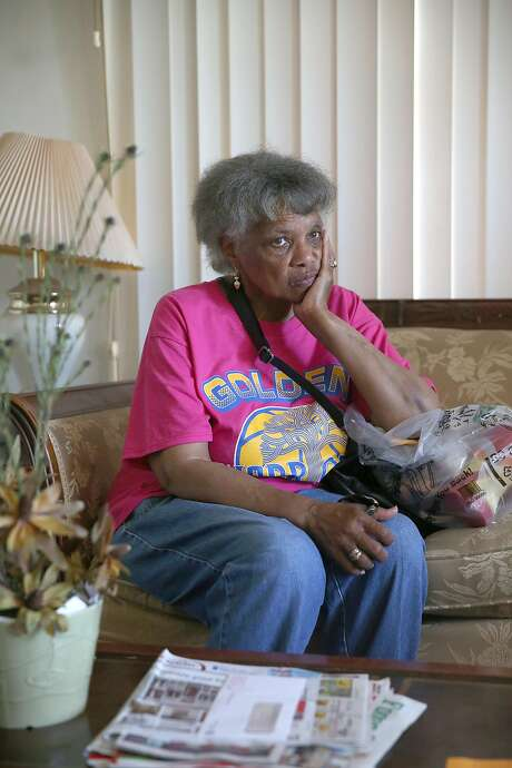 Dorothy DeBose, an East Oakland woman who was evicted from her house in March,and recently moved back into the home she lost to foreclosure talks with a friend on Tuesday, May 2, 2017, in Oakland, Calif.  Wells Fargo foreclosed on the house which was subsequently purchased by Community Fund LLC, a San Leandro company, which paid $347,000, and selling it back to DeBose for $420,000. Photo: Liz Hafalia, The Chronicle