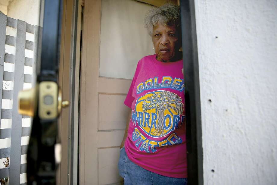 Dorothy DeBose is back in her East Oakland home where a lock was stripped and door nailed closed after her eviction and foreclosure on the property. Photo: Liz Hafalia, The Chronicle
