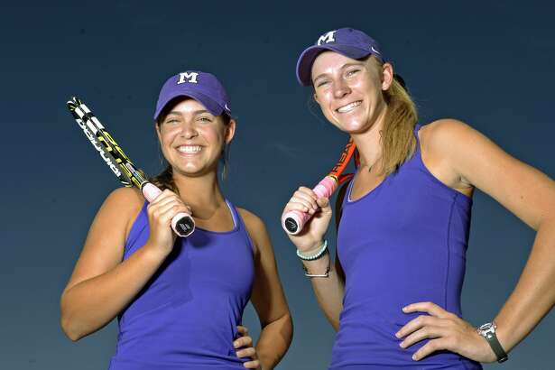 Midland High's Allison Stewart, left, and Kate Daugherty, right, in portrait May 2, 2017, at the Midland High tennis courts.  James Durbin/Reporter-Telegram