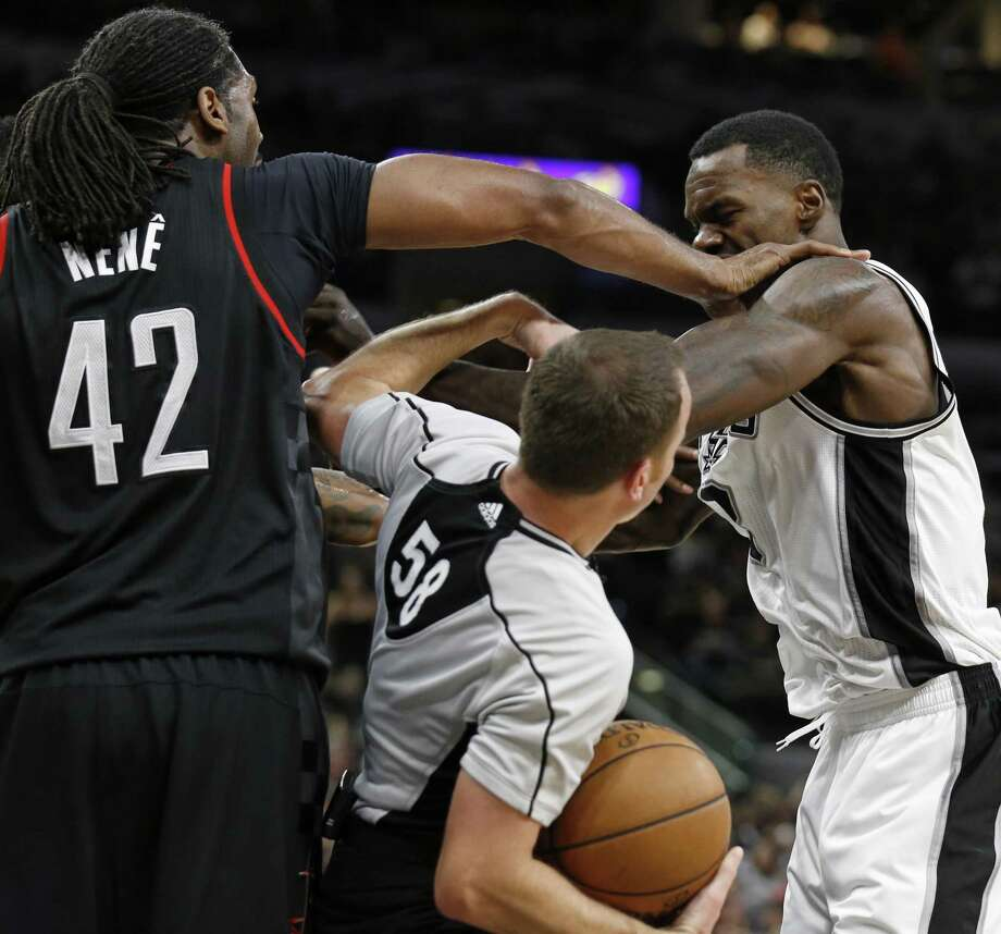 Houston Rockets' Nene and the Spurs' Dewayne Dedmon argue as official Josh Tiven moves in at the end of the third quarter during Game 1 on May 1, 2017 at the AT&T Center. Nene was ejected. The Rockets won 126-99. Photo: Edward A. Ornelas /San Antonio Express-News / © 2017 San Antonio Express-News
