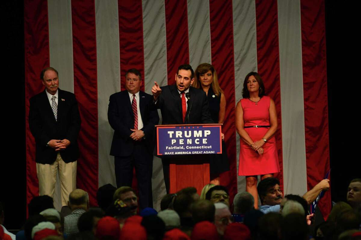 State chairman of the State GOP J.R. Romano addresses the crowd at the Trump Rally at Sacred Heart University Saturday, August 13, 2016 in Fairfield, Conn.