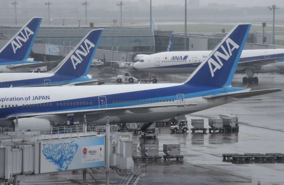 FILE -- All Nippon Airways (ANA) aircrafts are seen parked at Haneda Airport in Tokyo on April 28, 2016. An American passenger aboard an ANA flight was arrested after allegedly urinating on another passenger, during a flight from the United States to Japan.