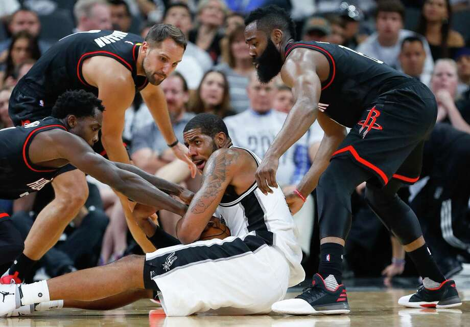 Spurs forward LaMarcus Aldridge tries to hold onto a loose ball during the second half of Game 1 at the AT&T Center on May 1, 2017, in San Antonio. Photo: Karen Warren /Houston Chronicle / 2017 Houston Chronicle