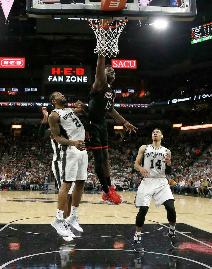 Houston Rockets center Clint Capela (15) dunks the ball against San Antonio Spurs forward Kawhi Leonard (2) during the second half of Game 1 of the second-round of the Western Conference NBA playoffs at AT&T Center,  Monday, May 1, 2017, in San Antonio. ( Karen Warren / Houston Chronicle ) Photo: Karen Warren, Staff Photographer / 2017 Houston Chronicle