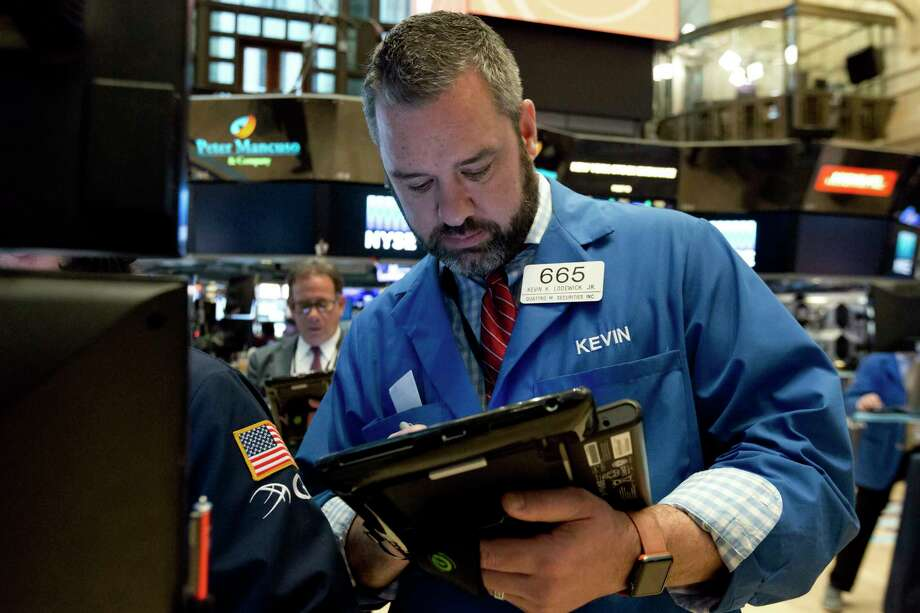 Trader Kevin Lodewick works on the floor of the New York Stock Exchange, Tuesday, May 2, 2017. U.S. stocks are opening slightly higher as investors find a lot to like in corporate first-quarter results. (AP Photo/Richard Drew) Photo: Richard Drew, STF / AP