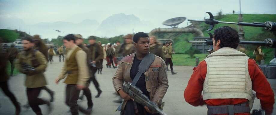 Star Wars: The Force Awakens  L to R: Finn (John Boyega) and Poe Dameron (Oscar Isaac)  Ph: Film Frame  © 2014 Lucasfilm Ltd. & TM. All Right Reserved.. Photo: 2014 Lucasfilm Ltd. & TM. All Right Reserved..