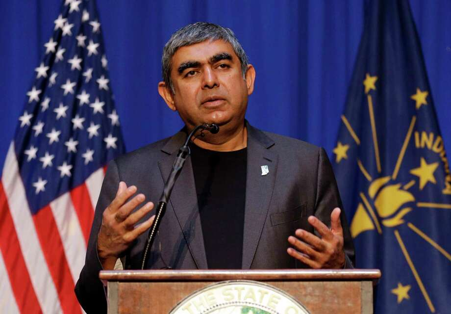 CEO Vishal Sikka announces in Indianapolis that Infosys plans for 10,000 U.S. jobs. Photo: Michael Conroy, STF / Copyright 2017 The Associated Press. All rights reserved.