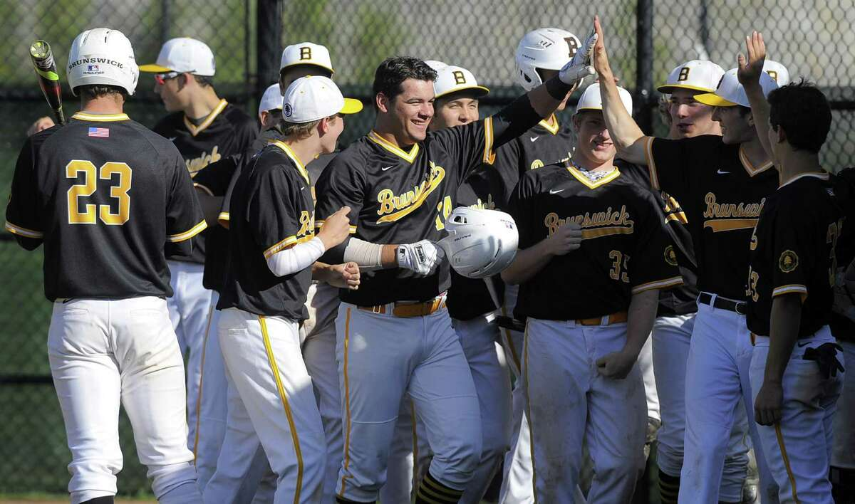 Brunswick Aaron Sabato, center, celebrates with teammates following his second two-run homerun of the game, coming in the fourth inning against Hamden Hall, in a boys varsity baseball game at Brunswick School in Greenwich, Conn. on May 2, 2017.