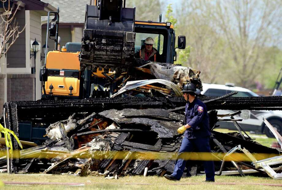 Debris is removed April 18 from a house that was destroyed a day earlier in a deadly explosion in Firestone, Colo. Photo: Matthew Jonas, MBO / Prairie Mountain Media 2017