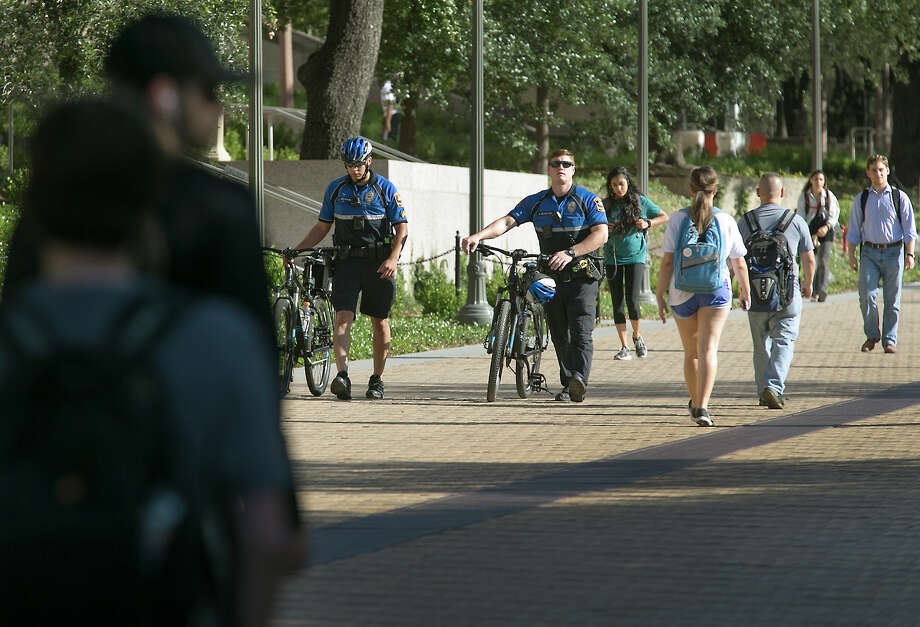 University of Texas Police  patrol the Austin campus on Tuesday, the day after a student was fatally stabbed. Police stepped up patrols and officials urged students to walk in pairs and stay in well-lit areas. Photo: Ralph Barrera, MBO / Austin American-Statesman