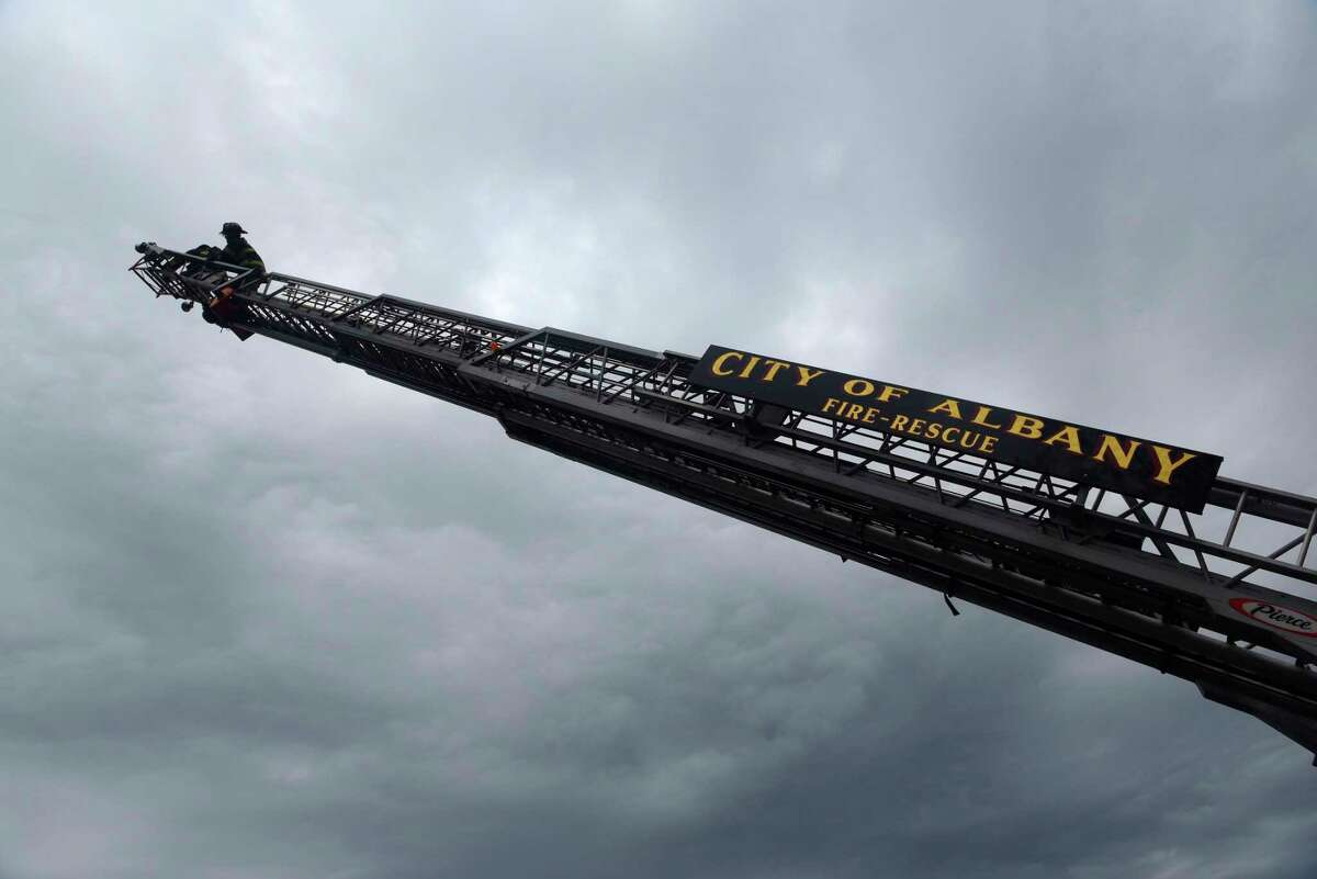 Albany Councilman Frank Commisso Jr. makes his way up a ladder as he's followed by Albany Firefighter Adam Mason at the Colonie Municipal Training Center on Tuesday, May 2, 2017, in Latham, N.Y. Local media representatives along with local and statewide elected officials took part in a hands-on event where they experienced the kind of work firefighters do. (Paul Buckowski / Times Union)