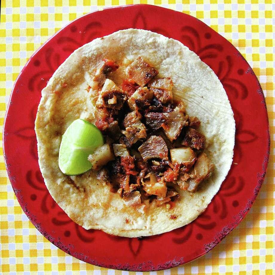 Chicharrón prensado taco on a handmade corn tortilla from Mi Ranchito. Photo: Mike Sutter /San Antonio Express-News