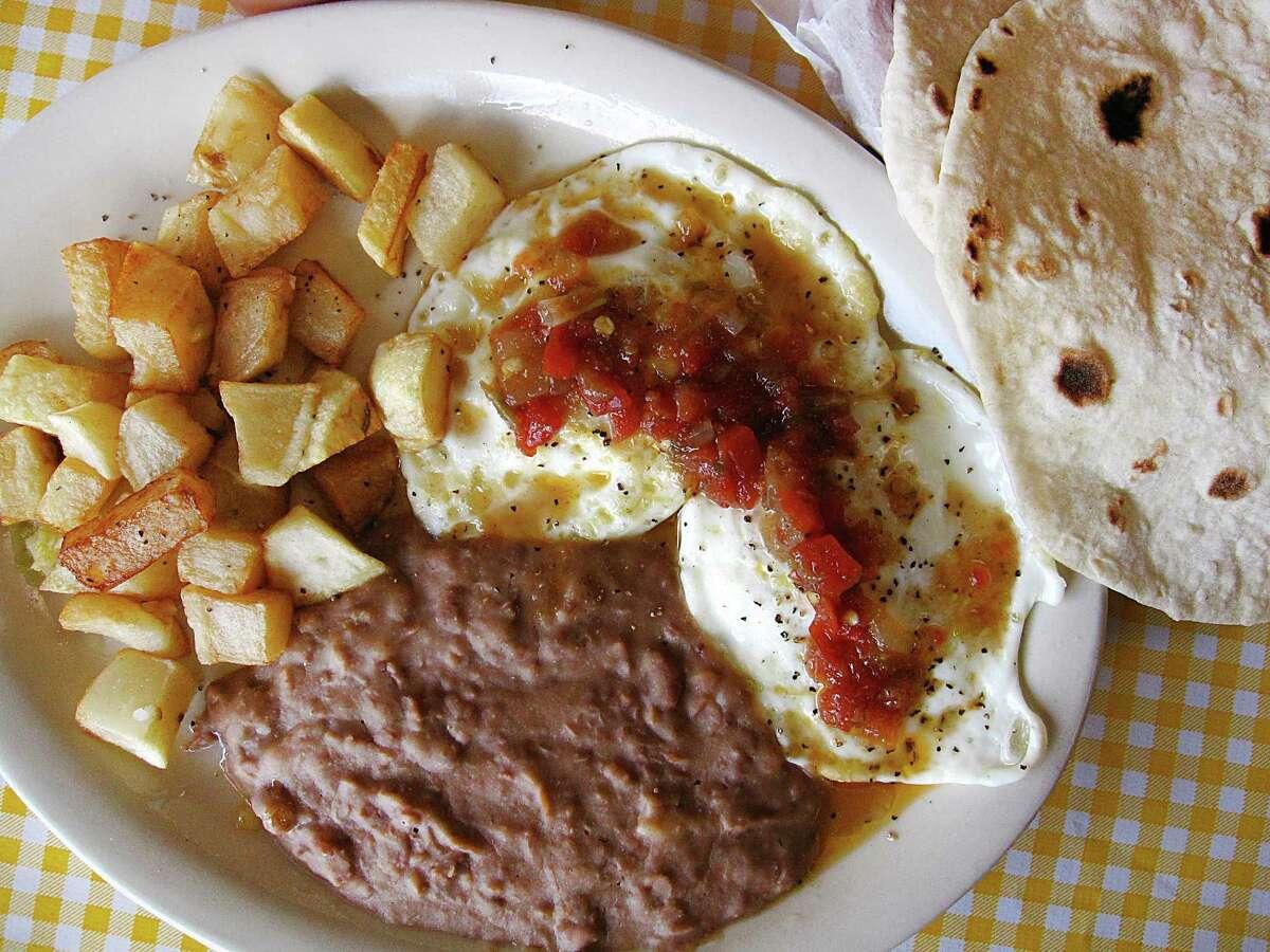 Huevos rancheros plate with handmade flour tortillas from Mi Ranchito.
