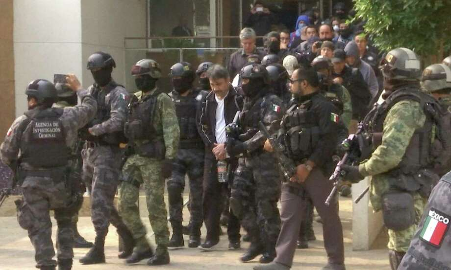 """This frame grab from video shows Damaso Lopez, known by the nickname """"El Licenciado,"""" escorted by police after his capture at an upscale apartment building on a major boulevard in Mexico City, Tuesday, May 2, 2017. Mexican prosecutors said they captured Lopez, one of the Sinaloa cartel leaders who launched a struggle for control of the gang following the re-arrest of Joaquin """"El Chapo"""" Guzman. Lopez was long considered Guzman's right-hand man and helped him escape from a Mexican prison in 2001. (AP Photo/Jorge Barrera, APTN) Photo: Jorge Barrera, STF / Copyright 2017 The Associated Press. All rights reserved."""