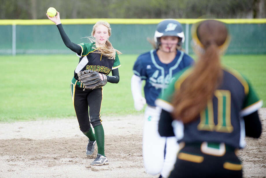 BRITTNEY LOHMILLER | blohmiller@mdn.net Top: Dow High's Krista Moe prepares to throw to teammate Kylee Alexander during a rundown in Tuesday's game vs. Lapeer. Above Left: Dow's Grace Pnacek delivers a pitch to a Lapeer batter. Above Right: Lapeer's Brooklyn Withey beats the throw to Dow first-baseman Baylee Rohn. / Midland Daily News