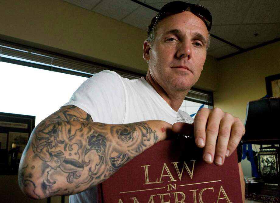 Newly elected State District Judge Kevin Fine (cq), shows his sleeve of tattoos Friday, Nov. 14, 2008 in his downtown office in Houston. Fine used his life experience of beating drug addiction for his campaign. ( Nick de la Torre / HOUSTON CHRONICLE ) Photo: Nick De La Torre, Staff / © 2008 HOUSTON CHRONICLE
