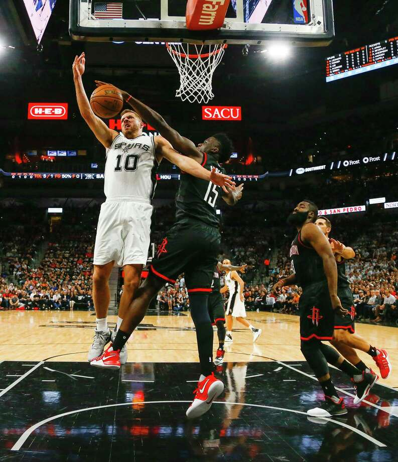 Rockets center Clint Capela, right, was a force in stifling David Lee and his Spurs teammates in the paint in Game 1's rout Monday at AT&T Center. Photo: Karen Warren, Staff Photographer / 2017 Houston Chronicle