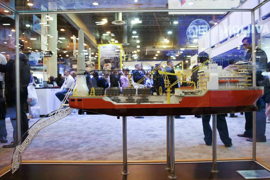 FILE - A model of the TechnipFMC  M/V Global 1200 at the Offshore Technology Conference at NRG Center on May 2, 2017 in Houston, Texas. Friday, the Paris and Houston-based company announced they had cut more than 3,000 jobs worldwide. Photo: Michael Ciaglo, Houston Chronicle / Michael Ciaglo