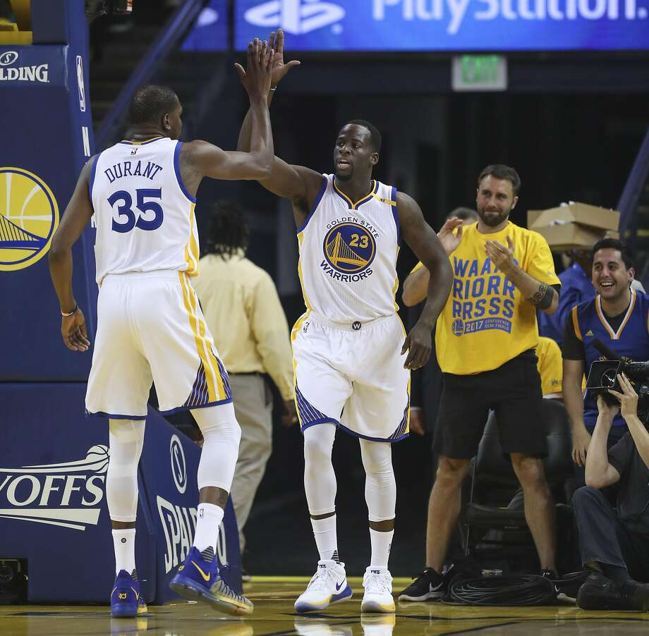 Golden State Warriors' Kevin Durant and Draymond Green high five after a play in the first quarter during Game 1 of the Western Conference Semifinals 2017 NBA Playoffs at Oracle Arena on Tuesday, May 2, 2017 in Oakland, Calif. Photo: Scott Strazzante, The Chronicle
