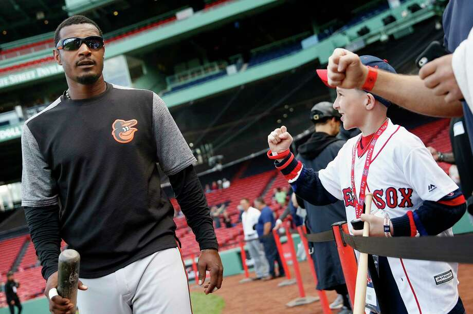 Fans react as Baltimore Orioles' Adam Jones walks to the dug out before a baseball game against the Boston Red Sox, Tuesday, May 2, 2017, in Boston. (AP Photo/Michael Dwyer) ORG XMIT: MAMD105 Photo: Michael Dwyer / Copyright 2017 The Associated Press. All rights reserved.