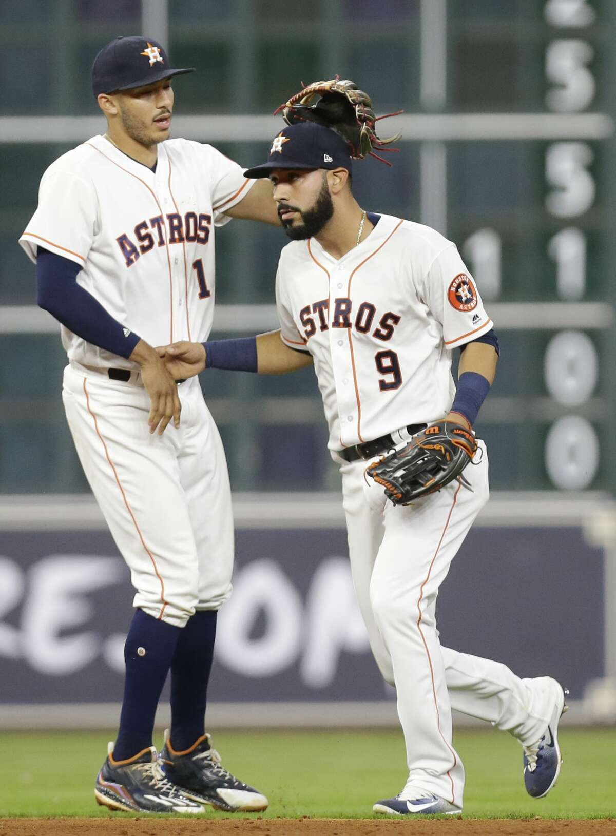 Houston Astros Carlos Correa and Marwin Gonzalez celebrate win over the Texas Rangers at Minute Maid Park Tuesday, May 2, 2017, in Houston. ( Melissa Phillip / Houston Chronicle )
